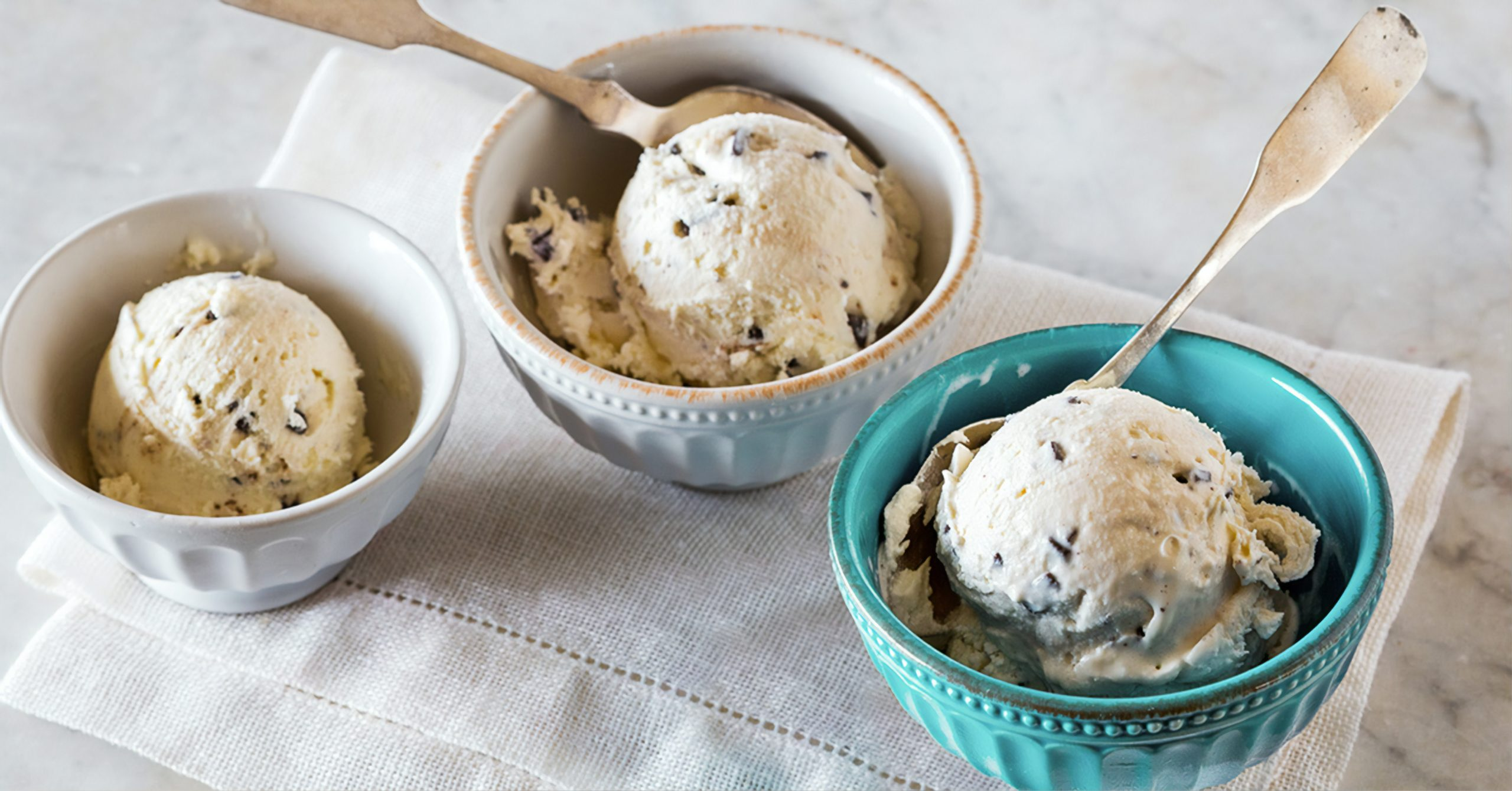 Ice cream in several bowls.